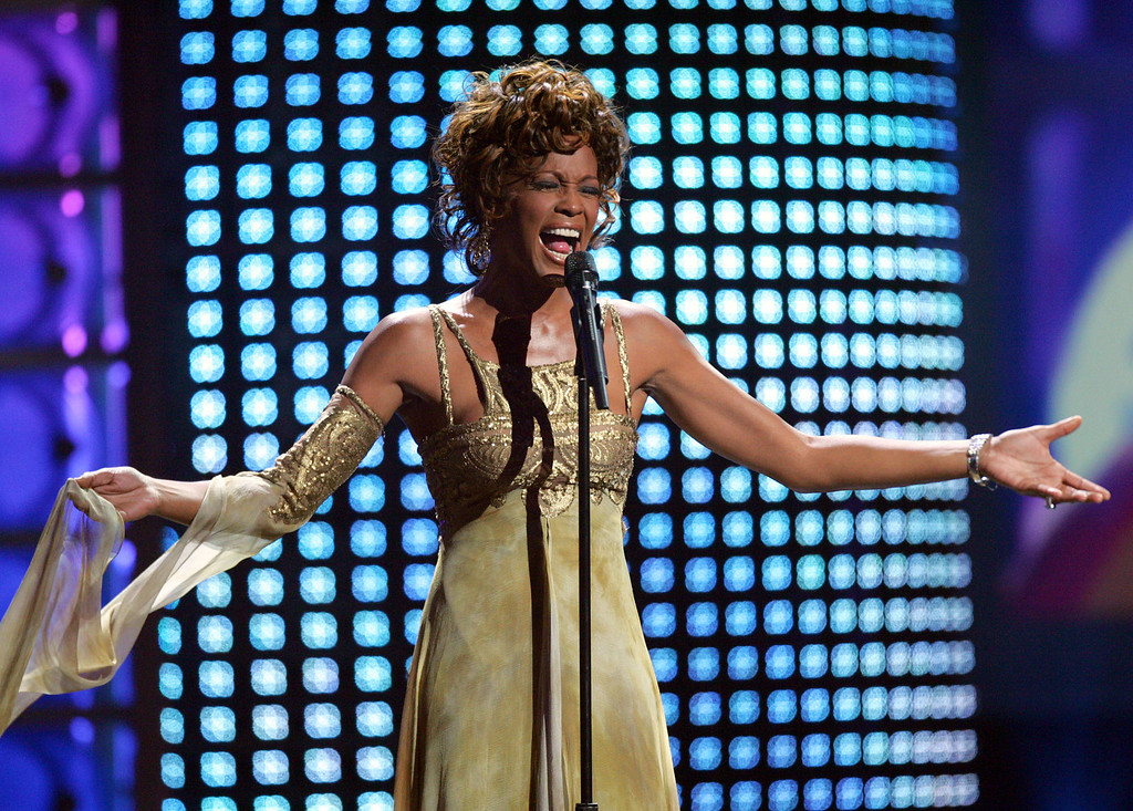 . Recording artist Whitney Houston performs at the 2004 World Music Awards Wednesday, Sept. 15, 2004, at the Thomas and Mack Arena in Las Vegas. (AP Photo/Eric Jamison)