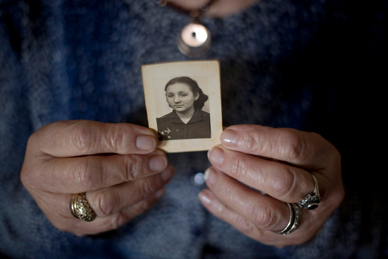 . Warsaw ghetto Holocaust survivor Aliza Vitis-Shomron holds a photograph of herself when she was about 17 years old as she sits in her living room in Kibbutz Givat Oz, Israel on April 4, 2013. Two days before her comrades embarked on an uprising that came to symbolize Jewish resistance against the Nazis in World War II, 14-year-old Aliza Mendel got her orders: Escape from the Warsaw Ghetto. The end was near. Nazi troops had encircled the ghetto, and the remaining Jewish rebels inside were prepared to die fighting. Her job, they told her, was to survive and tell the world about how the fighters died resisting the Nazis. In the 70 years since the revolt, she\'s been doing just that, publishing a memoir about life in the ghetto and lecturing about the uprising.   (AP Photo/Ariel Schalit)