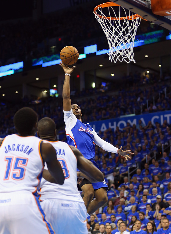 . Chris Paul #3 of the Los Angeles Clippers takes a shot against the Oklahoma City Thunder in Game One of the Western Conference Semifinals during the 2014 NBA Playoffs at Chesapeake Energy Arena on May 5, 2014 in Oklahoma City, Oklahoma.   (Photo by Ronald Martinez/Getty Images)