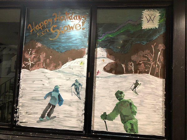 Window Painting Spreads Holiday Cheer