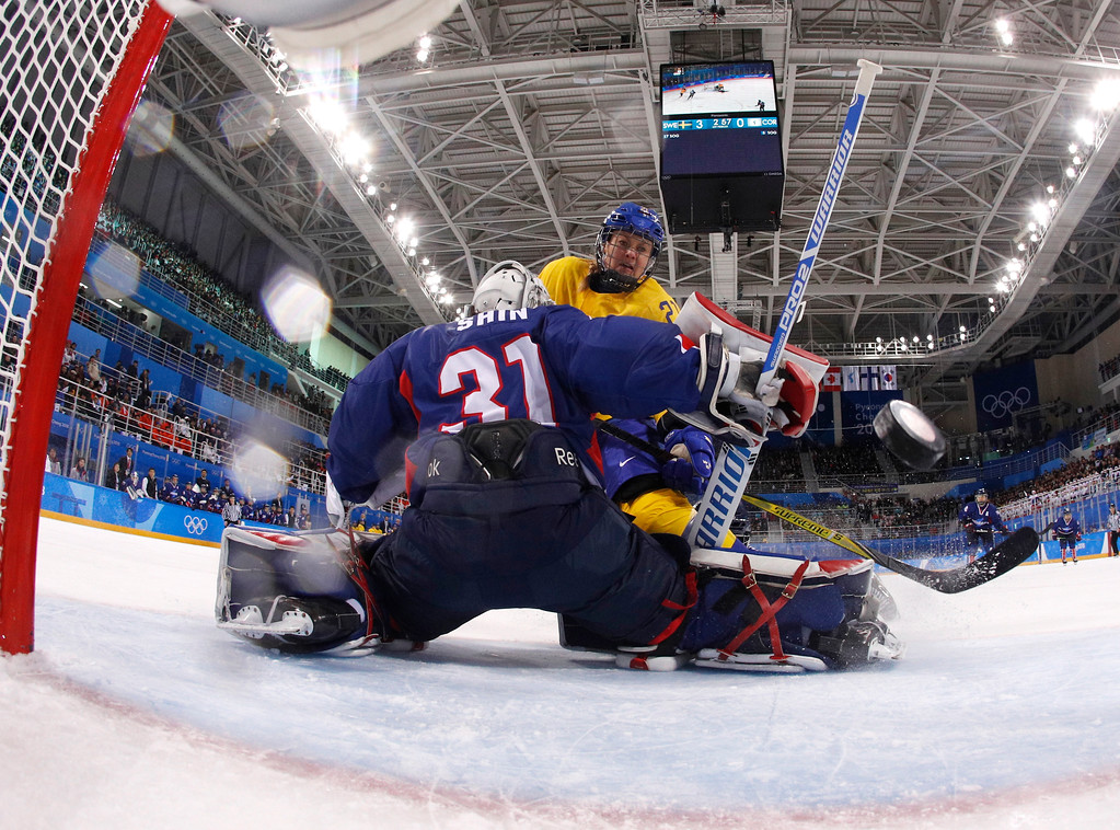 . Johansson Erica Uden (21), of Sweden, scores a goal against South Korea\'s goalie Shin So-jung (31), of the combined Koreas team, during the first period of the preliminary round of the women\'s hockey game at the 2018 Winter Olympics in Gangneung, South Korea, Monday, Feb. 12, 2018. (Kyung Hoon Kim/Pool Photo via AP)
