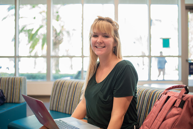 Melissa Damschen works on her psychology assignments in the University Center Tejas Lounge before class.