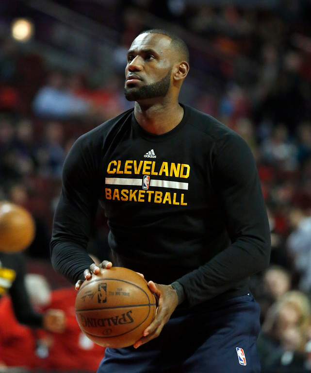 . Cleveland Cavaliers forward LeBron James warms up before an NBA basketball game against the Chicago Bulls Thursday, March 30, 2017, in Chicago. (AP Photo/Nam Y. Huh)