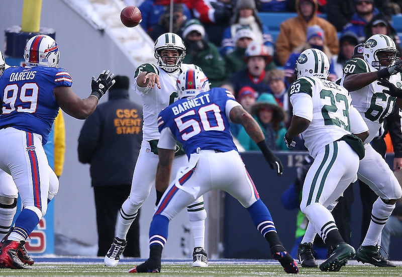 . Mark Sanchez #6 of the New York Jets completes a pass to Shonn Greene #23 during an NFL game against the Buffalo Bills at Ralph Wilson Stadium on December 30, 2012 in Orchard Park, New York. (Photo by Tom Szczerbowski/Getty Images)