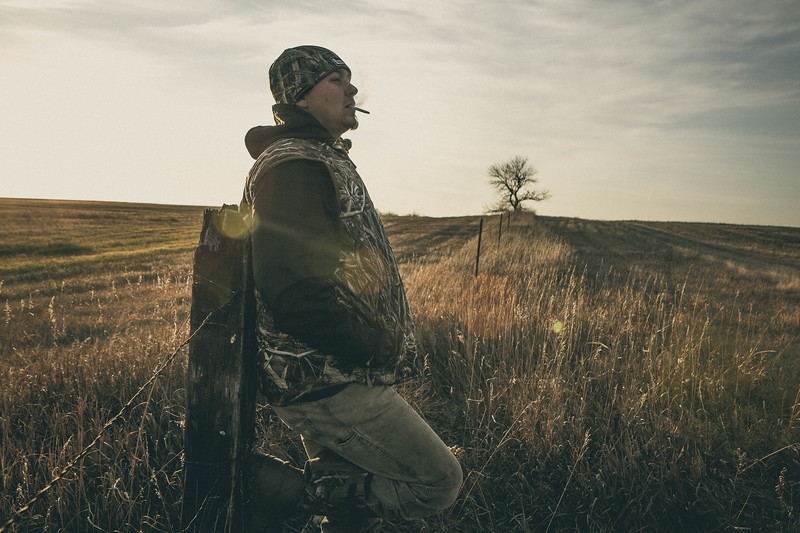 A hunter scouting for ducks in South Dakota.
