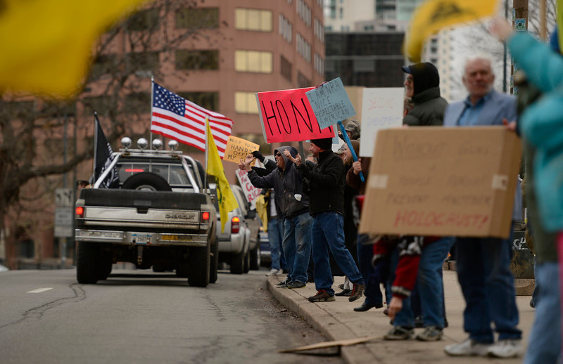 . People, opposed to future gun laws, line the sidewalks for a rally, March, 04, 2013, outside the Colorado State Capitol. (Photo By RJ Sangosti/The Denver Post)