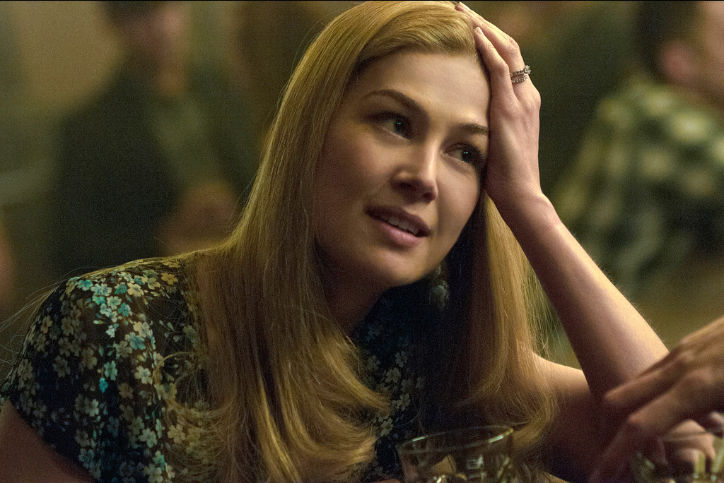 """. FILE - In this image released by 20th Century Fox, Rosamund Pike appears in a scene from \""""Gone Girl.\"""" Pike was nominated for a Golden Globe for best actress in a drama for her role in the film on Thursday, Dec. 11, 2014. The 72nd annual Golden Globe awards will air on NBC on Sunday, Jan. 11. (AP Photo/20th Century Fox, Merrick Morton, File)"""
