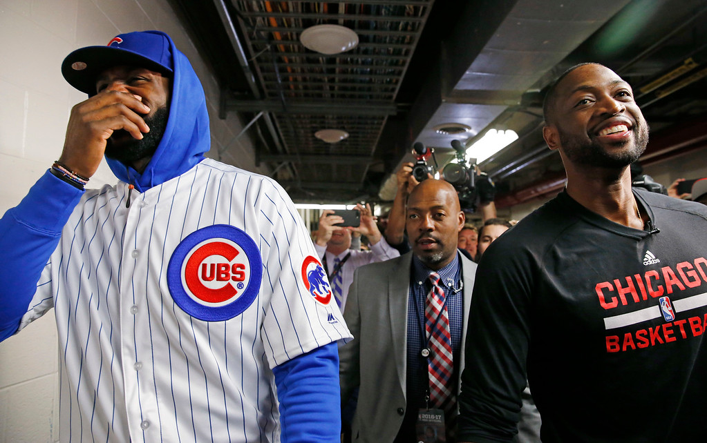 . Cleveland Cavaliers\' LeBron James, left, and Chicago Bulls\' Dwyane Wade smile as they walk on the hallway before an NBA basketball game Friday, Dec. 2, 2016, in Chicago. (AP Photo/Nam Y. Huh)