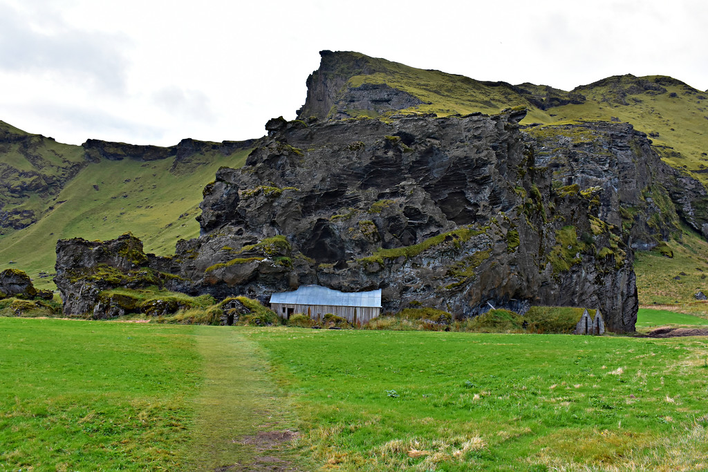 House built into a rock and turf houses along Iceland's South Coast road trip