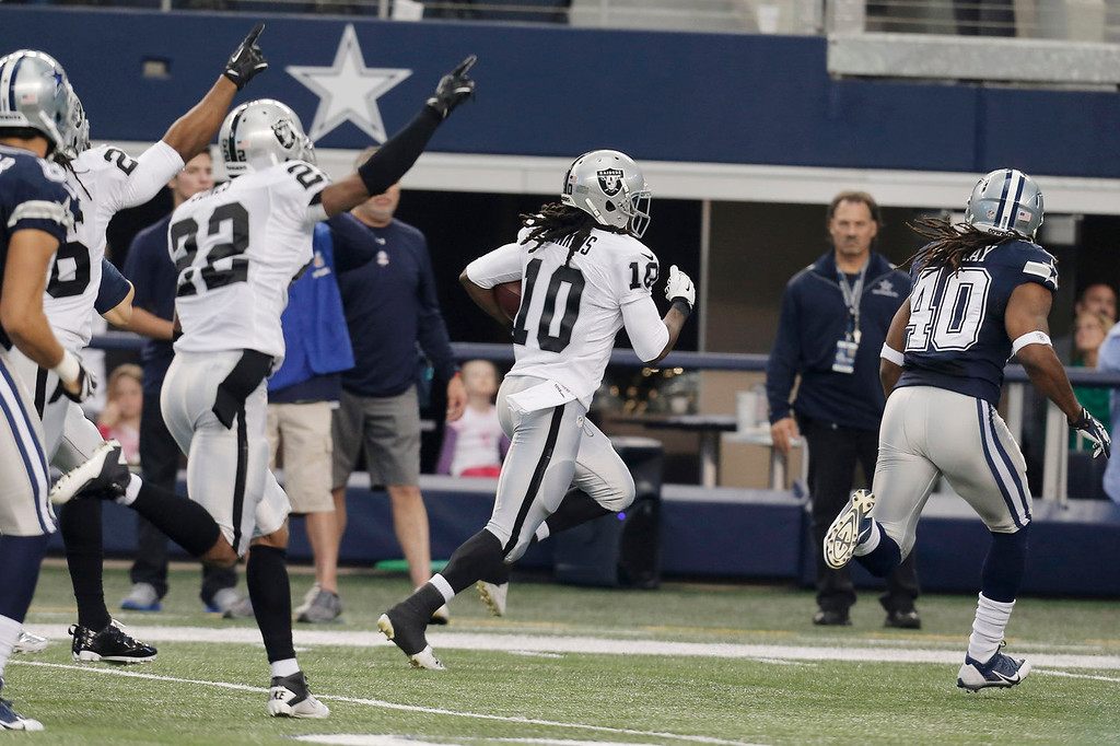 . Oakland Raiders wide receiver Greg Jenkins (10) runs in  a Dallas Cowboys fumble for a touchdown during the first have of an NFL football game, Thursday, Nov. 28, 2013, in Arlington, Texas.  (AP Photo/Brandon Wade)