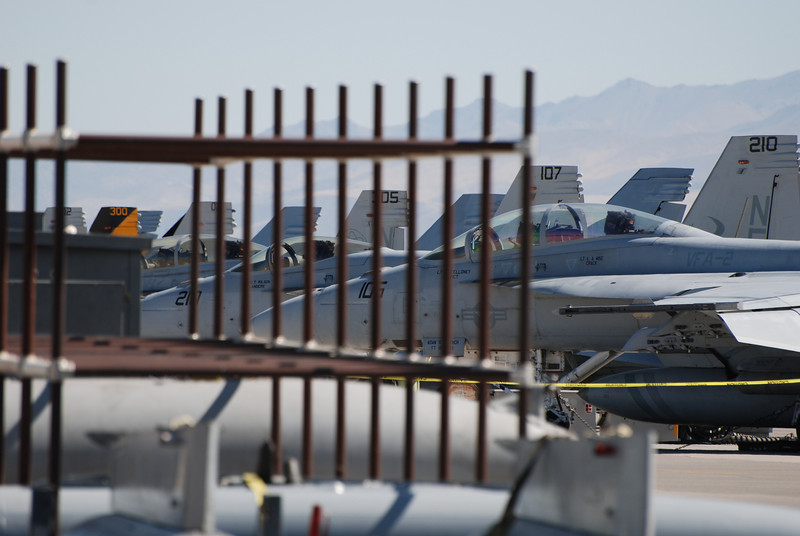caged hornets.  A long line of F/A-18 Hornets and Super Hornets comprise the transient line at NAS Fallon.