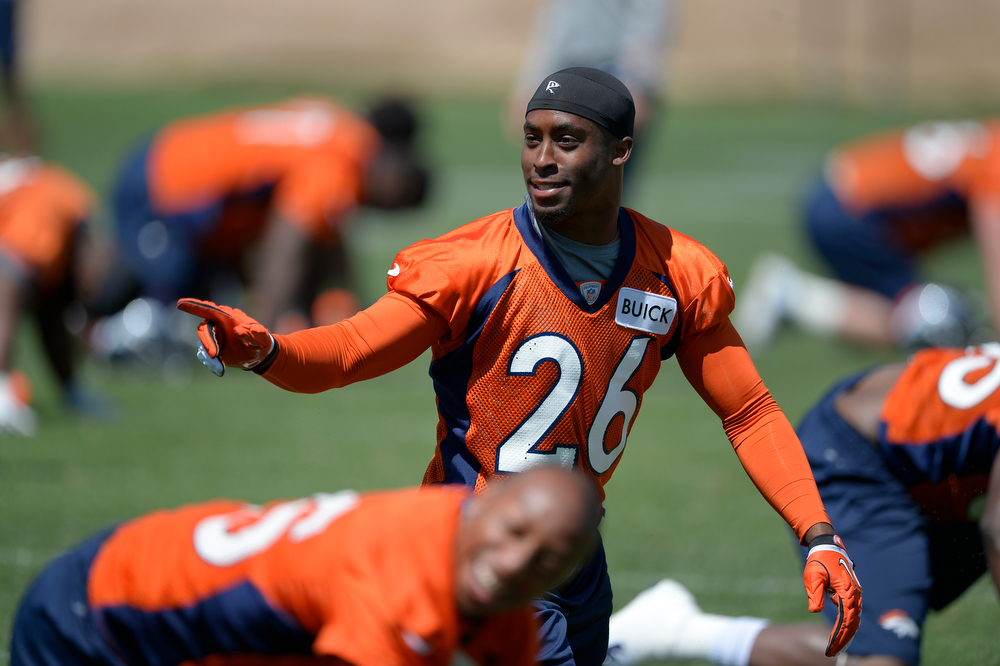 . Denver Broncos Rahim Moore (26) stretches during OTAs June 12, 2014 at Dove Valley. (Photo by John Leyba/The Denver Post)