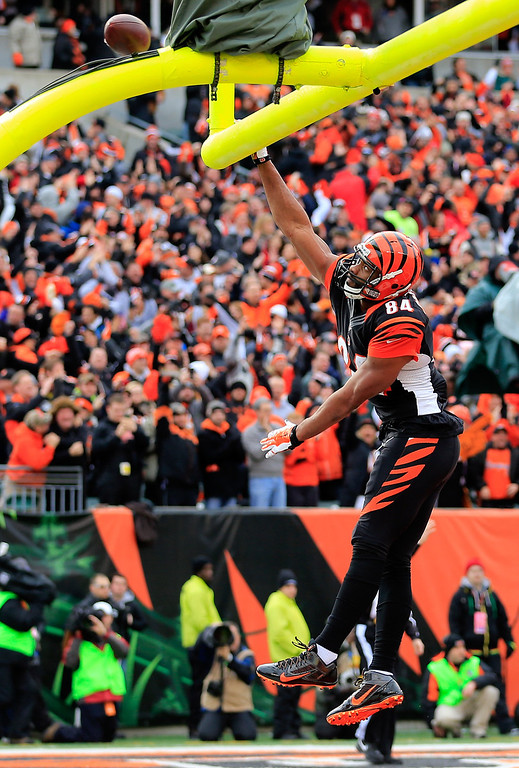 . Tight end Jermaine Gresham #84 of the Cincinnati Bengals celebrates a second quarter touchdown against the San Diego Chargers during a Wild Card Playoff game at Paul Brown Stadium on January 5, 2014 in Cincinnati, Ohio.  (Photo by Rob Carr/Getty Images)