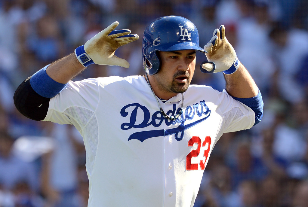 . Dodgers first baseman Adrian Gonzalez gestures after hitting a home run in the third inning of game 5 of the NLCS at Dodger Stadium Wednesday, October 16, 2013.  The Dodgers won the game 6-4.(David Crane/Los Angeles Daily News)