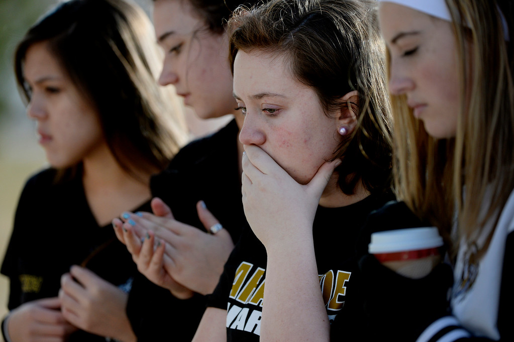 . Senior Hannah Eddy joins classmates at the tribute area outside Arapahoe High School in Centennial, CO December 19, 2013. Seniors and Juniors returned to the school for two hour periods Thursday, Sophomores and Freshmen will return on Friday. (Photo By Craig F. Walker / The Denver Post)