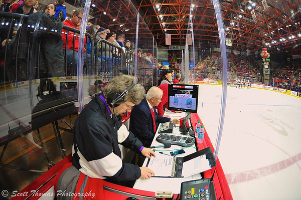 Binghamton Senators and AHL game officials keeping game statistics, time and video access to the overhead net cameras during a game with the Syracuse Crunch in American Hockey League (AHL) action at the Broome County Veterans Memorial Arena on Saturday, January 4, 2014.