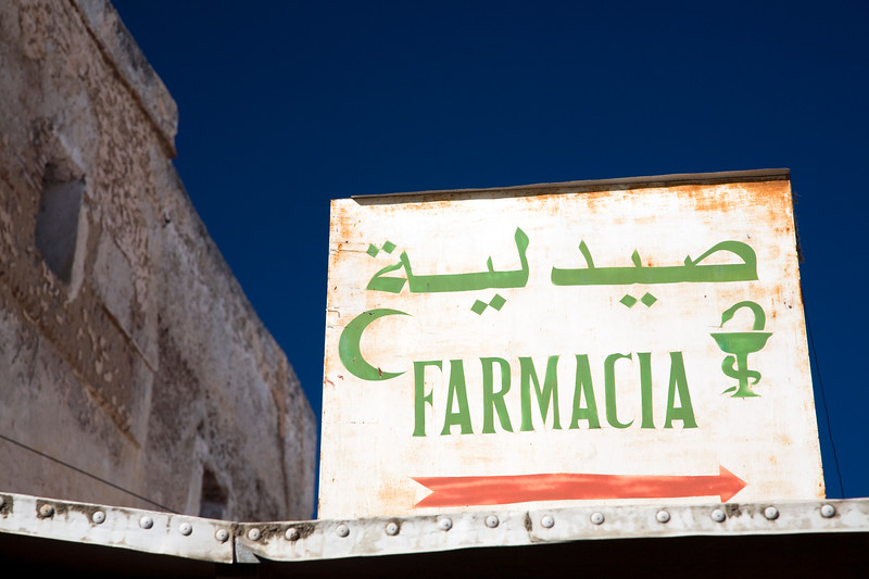 Sign of a pharmacy in Arabic and Spanish, Tetouan medina, Morocco