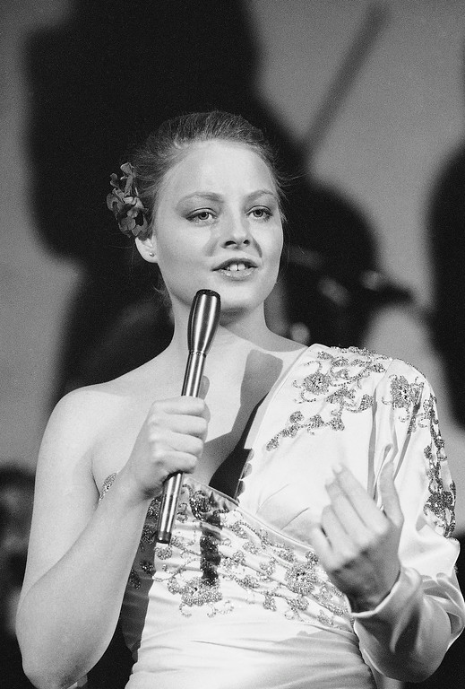 """. In this Feb. 13, 1982 file photo, actress Jodie Foster rehearses a song during filming of a television production \""""Svengali\"""" in New York. John Hinckley shot President Ronald Reagan in 1981 in an attempt to impress the Oscar-winning actress Foster, who he had been writing poems and letters to in an attempt to establish a relationship. He was ruled legally insane at the time of the shooting and was sent to a state mental hospital. Since 2006, Hinckley has been receiving additional privileges and earlier this year was granted release from the hospital for 17 days a month to visit his mother in Virginia.  (AP Photo/Suzanne Vlamis, file)"""