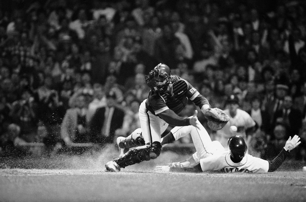 . Detroit?s Lou Whitaker scores as ball gets past San Diego catcher Terry Kennedy during second inning at night, Friday, Oct. 12, 1984 in Detroit in the World Series at Tiger Stadium. He scored on Alan Trammell?s hit. (AP Photo/Rich Sheinwald)
