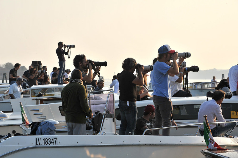 . Photographers aim their cameras to catch George Clooney on his way to his wedding with Amal Alamuddin, in Venice, Italy, Saturday, Sept. 27, 2014. (AP Photo/Luigi Costantini)