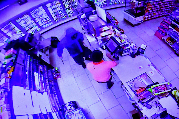 10/31/2019 Mike Orazzi | Staff Still images from an armed robbery by a man wielding a knife at the 7-Eleven on Riverside Avenue in Bristol early Wednesday morning.