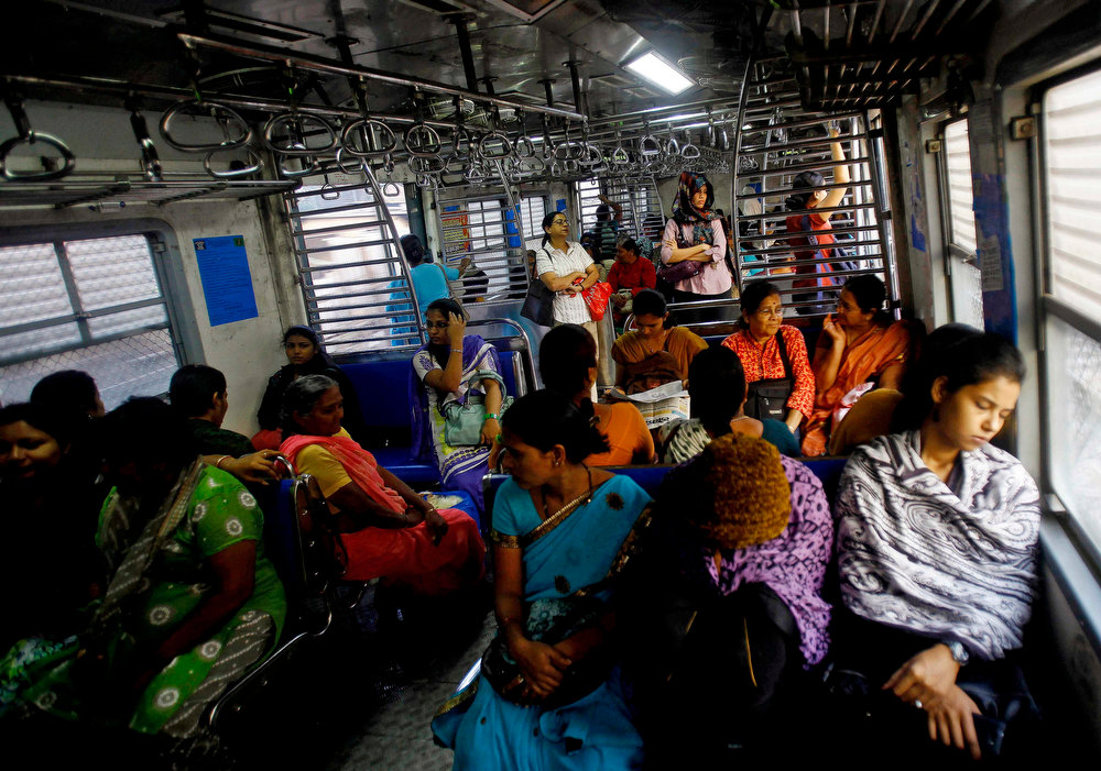 Description of . Indian women travel in the women's compartment of a train early morning in Mumbai, India, Thursday, Jan. 10, 2013. Five men have been charged with attacking the 23-year-old woman and a male friend on a bus as it was driven through the streets of India's capital. The woman was raped and assaulted with a metal bar on Dec. 16, 2012 and eventually died of her injuries. The case has sparked protests across India by women and men who say India's legal system doesn't do enough to prevent attacks on women. (AP Photo/Rafiq Maqbool)