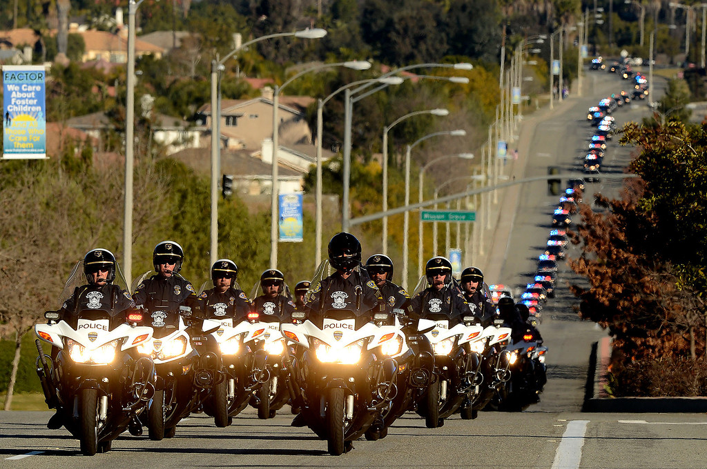 . Thousands of law enforcement agencies join a  police procession for Riverside Police Officer Michael Crain along Trautwein Road in Riverside February 13, 2013.  Crain was shot and killed last week by fugitive Christopher Dorner in Riverside.  GABRIEL LUIS ACOSTA/STAFF PHOTOGRAPHER