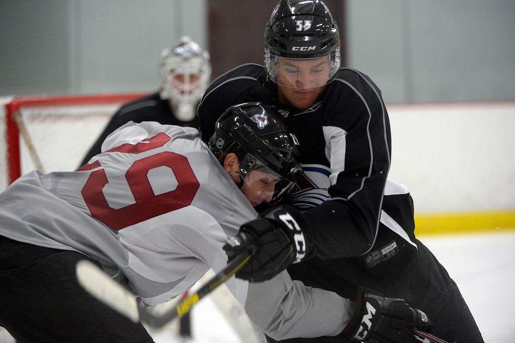 . Colorado Avalanche Michael Schumacher (53) battles for position with first round pick Nathan MacKinnon (29) during rookie camp September 8, 2013 at Family Sports. (Photo by John Leyba/The Denver Post)