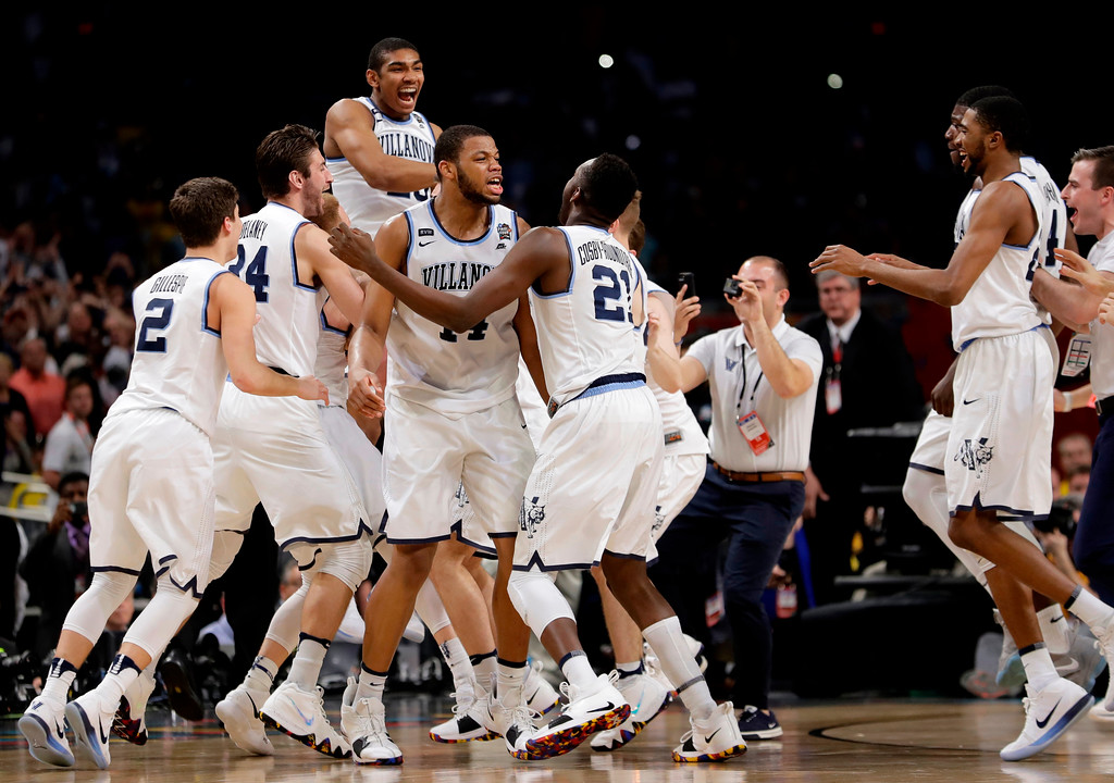 . Villanova players celebrate after defeating Michigan 79-62 in the championship game of the Final Four NCAA college basketball tournament, Monday, April 2, 2018, in San Antonio. (AP Photo/Eric Gay)