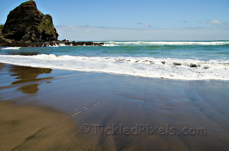 Piha Beach and Taitomo Island - Black sand, inviting surf, idyllic setting and a calmness.....
