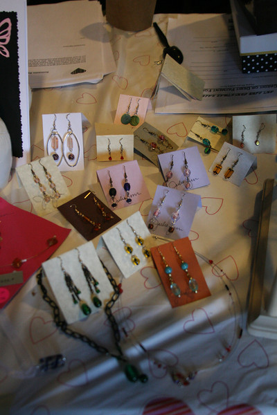 Several pairs of original earrings designed by students wait for customers outside the Caf.