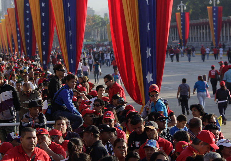. People line up outside the military academy  to see the body of Venezuela\'s late President Hugo Chavez lying in state in Caracas, Thursday, March 7, 2013.  Battling an unspecified cancer, Chavez died Tuesday. His body was taken to the military academy Wednesday, where he started his army career, his flag-draped coffin lying in state as a mile-long line of mourners came to pay homage Thursday.(AP Photo/Rodrigo Abd)