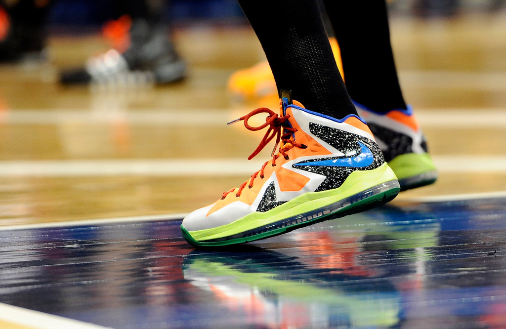 . West\'s Diana Taurasi, of the Phoenix Mercury, wearing sneakers in a color scheme she devised, waits for an inbound pass during the second half. (AP Photo/Jessica Hill)