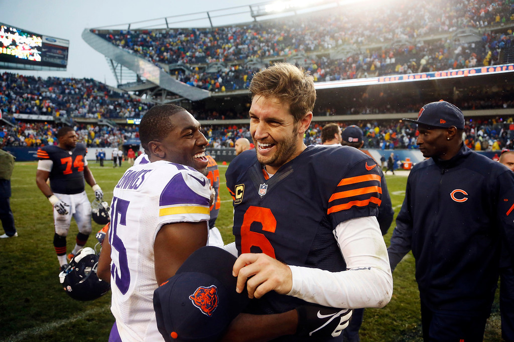 . Minnesota Vikings wide receiver Greg Jennings (15) and Chicago Bears quarterback Jay Cutler (6) laugh after their NFL football game on Sunday, Sept. 15, 2013, in Chicago. The Bears won 31-30. (AP Photo/Charles Rex Arbogast)