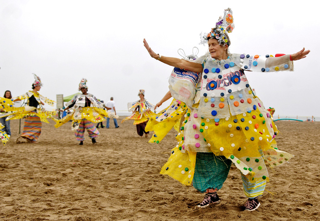 . Robin VanLear leads a parade of costumed dancers from the Cleveland Museum of Art\'s Parade the Circle during the 2013 Headlands BeachFest at Headlands Beach State Park. The 2017 event is 11 a.m. to 7 p.m. July 22, rain or shine. For more information, visit www.facebook.com/HeadlandsBeachFest.