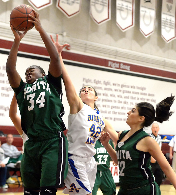 . Bonita\'s Nalah Massey (34) rebounds over Bishop Amat\'s Dagmar Ramirez (42) in the first half of the Covina basketball tournament at Covina High School in Covina, Calif., on Saturday, Dec. 14, 2013. Bonita won 49-41.   (Keith Birmingham Pasadena Star-News)