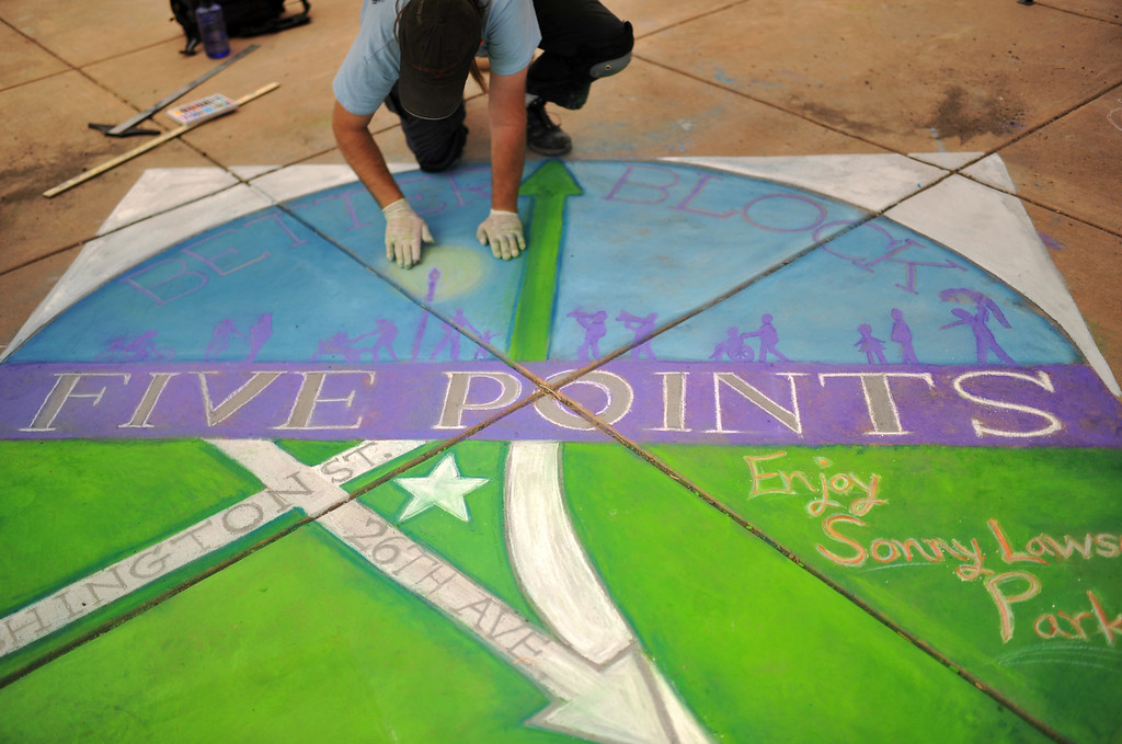 . DENVER, CO. - MAY 11 : Chalk artist Michael Rieger paints the logo of Five Points Better Block Project at Five Points in Denver, Colorado. May 11, 2013. People are celebrating the Five Points Better Block Project at Sonny Lawson Park. The event was an opportunity for The Five Points Better Block Project to demonstrate potential improvements for the neighborhood and provide tips to promote a stronger community. (Photo By Hyoung Chang/The Denver Post)