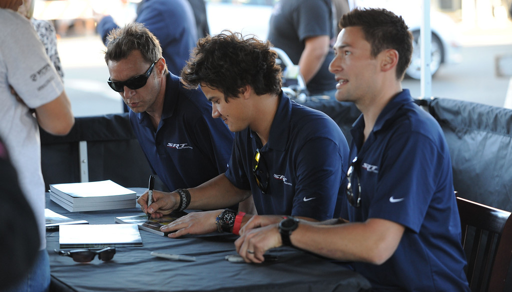 . Long Beach, Calif., -- 04-17-13-  American Le Mans Series drivers, left, to right Marc Goossens, Dominik Farnbacher  and Kuno Wittmer signed autographs  in Belmont Shore during The Second Annual �Roar in the Shore,�  a free event,that featured race cars on display, driver autograph sessions, children�s face painting, balloon artists and live music from 6 to 8:30 p.m. along Second Street between Corona and Covina avenues.   Stephen Carr/  Los Angeles Newspaper Group