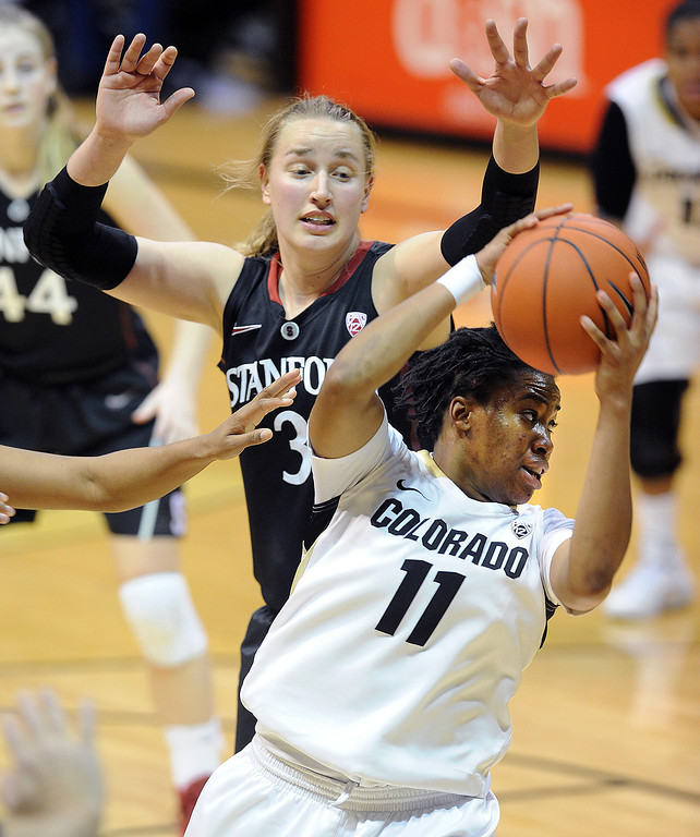 . Brittany Wilson of CUgets a rebound in front of Mikaela Ruef of Stanford during the second half of the January 12, 2014 game in Boulder. Cliff Grassmick/Daily Camera