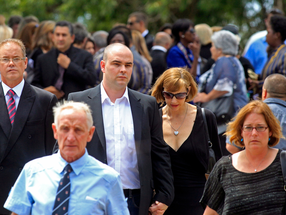 . Adam Steenkamp, centre left, the brother of Reeva Steenkamp, walks with family members after attending her funeral,  in Port Elizabeth, South Africa, Tuesday, Feb. 19, 2013. Olympic athlete Oscar Pistorius is charged with the murder of Reeva Steenkamp on Valentine\'s Day. The defense lawyer says it was an accidental shooting. (AP Photo/Schalk van Zuydam)