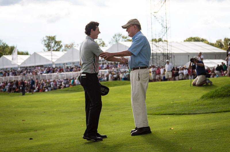Rory Mciiroy shakes hands with golf course architect Pete Dye after winning the 2012 BMW Championship at Crooked Stick Golf Course in Carmel Indiana on Sunday Sept. 9, 2012 (Charles Cherney/WGA)