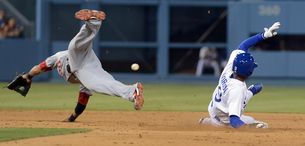 . Dee Gordon of the Dodgers steals second as the ball gets by Ian Desmond of the Nationals May 13, 2013 in Los Angeles, CA.(Andy Holzman/Staff Photographer)