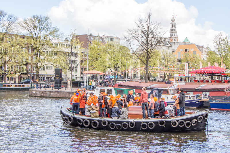 King's Day off the Amstel with the Zuidekerk in the background