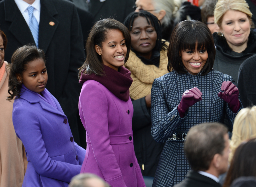 Description of . US Frist Lady Michelle Obama arrives with daughters Sasha (L) and Malia for the 57th Presidential Inauguration on January 21, 2013. US President Barack Obama will be ceremonially sworn in for a second term.  EMMANUEL DUNAND/AFP/Getty Images