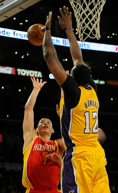. Rockets#7 Jeremy Lin is rejected by Lakers#12 Dwight Howard in the first quarter. The Lakers faced the Houston Rockets in the final home game of the year at Staples Center in Los Angeles, CA 4/17/2013(John McCoy/Staff Photographer