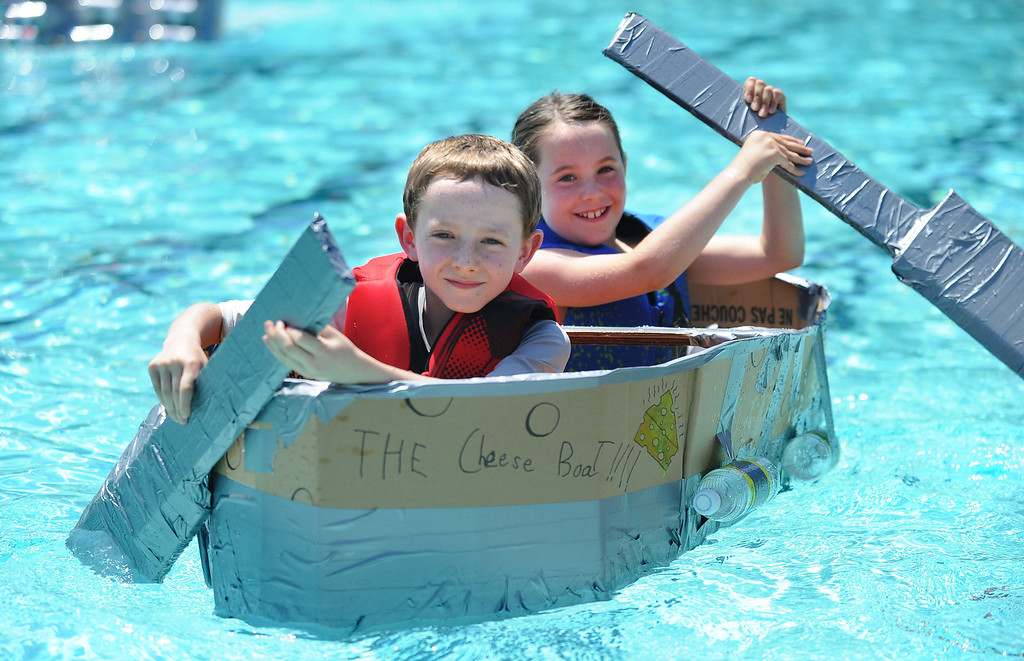 ". Toby Radding, left, and his sister Taylor Radding, 8, of Lafayette, paddle across a pool in their watercraft named ""The Cheese Boat!!!\"" made of only cardboard, recyclables and duct tape during the Derby Day boat race held at Pleasant Hill Aquatic Park in Pleasant Hill, Calif., on Friday, July 19, 2013. (Doug Duran/Bay Area News Group)"