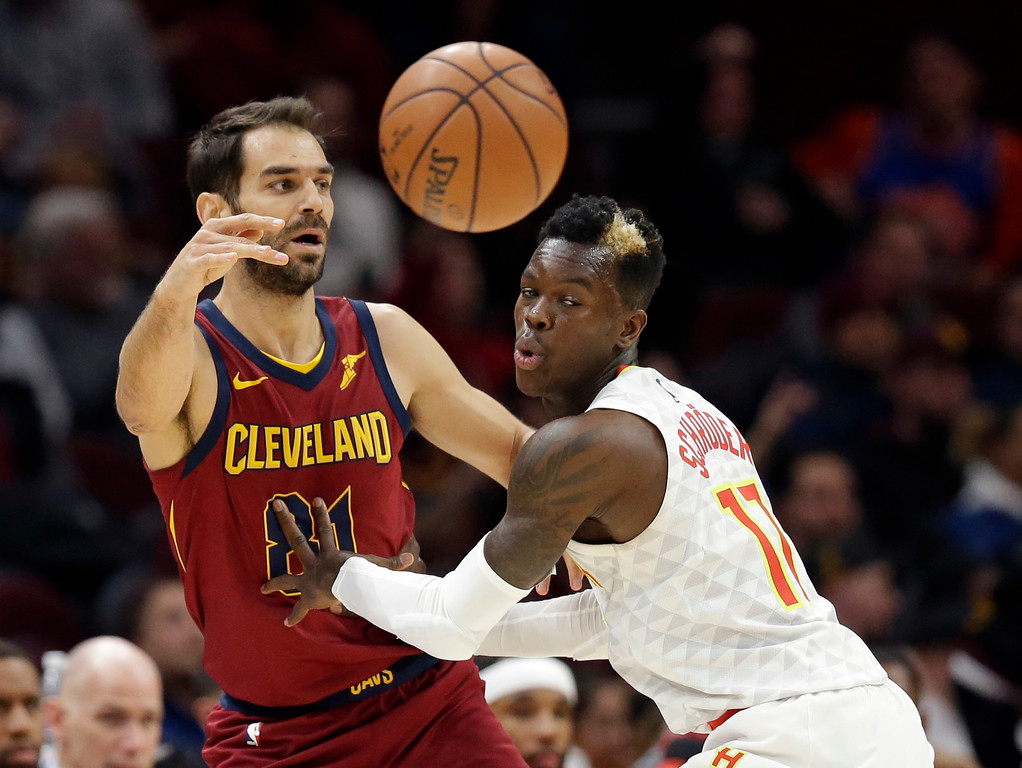 . Cleveland Cavaliers\' Jose Calderon (81), from Spain, passes against Atlanta Hawks\' Dennis Schroder (17), from Germany, in the first half of an NBA basketball game, Tuesday, Dec. 12, 2017, in Cleveland. (AP Photo/Tony Dejak)