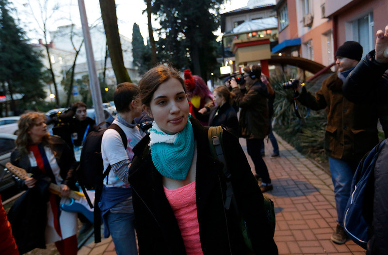 . Pussy Riot member Nadezhda Tolokonnikova walks on a sidewalk in Sochi, Russia, on Wednesday, Feb. 19, 2014. Cossack militia attacked the punk group with horsewhips earlier in the day as the artists - who have feuded with Vladmir Putin\'s government for years - tried to perform under a sign advertising the Sochi Olympics. (AP Photo/David Goldman)