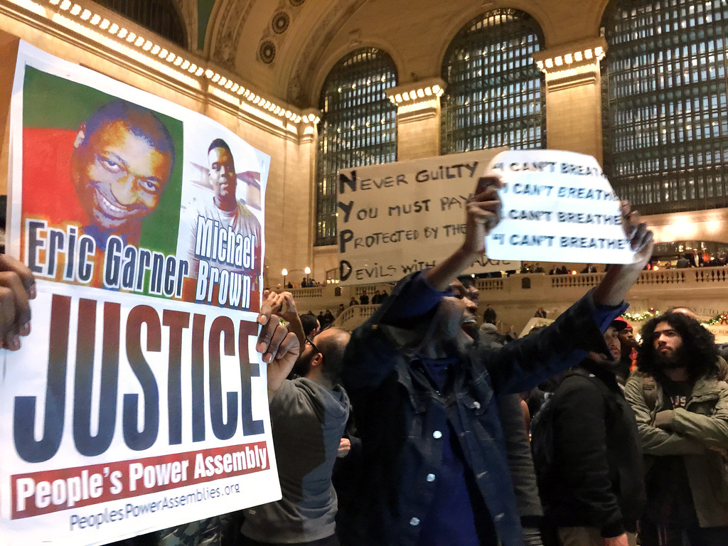 . People protest in Grand Central Terminal after it was announced that the New York City police officer involved in the death of Eric Garner was not indicted, Wednesday, Dec. 3, 2014, in New York. A grand jury cleared the white New York City police officer Wednesday in the videotaped chokehold death of Garner, an unarmed black man, who had been stopped on suspicion of selling loose, untaxed cigarettes.  (AP Photo/Jaime Holguin)