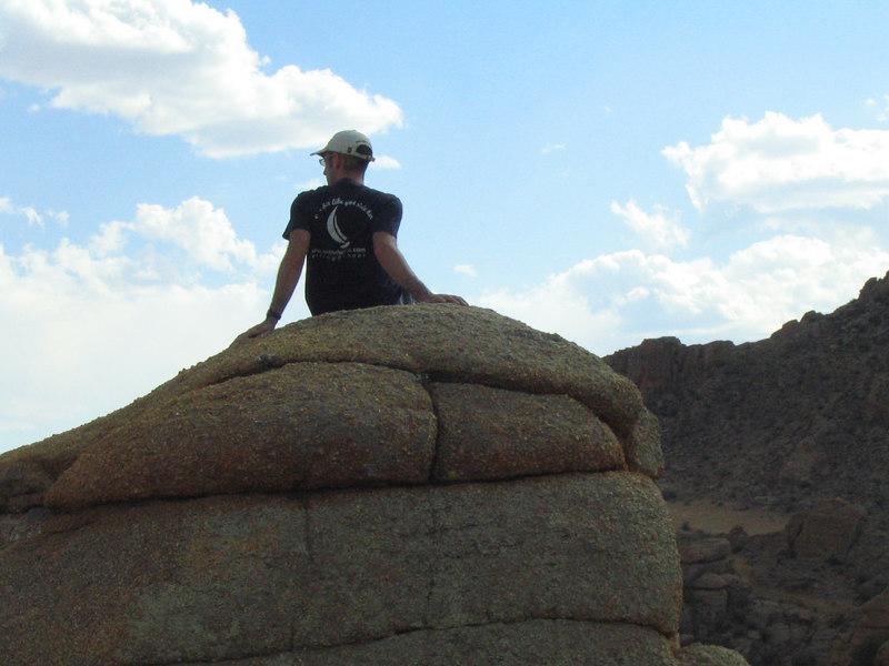 Scott taking a moment on a rock.